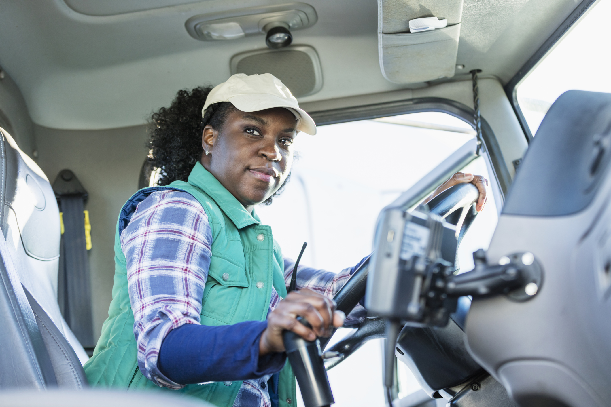 African-American woman driving a semi-truck